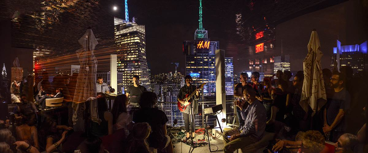 California-based band Bouquet took their audience above the clouds, on the Hyatt roof deck, to serenade them against the city skyline.