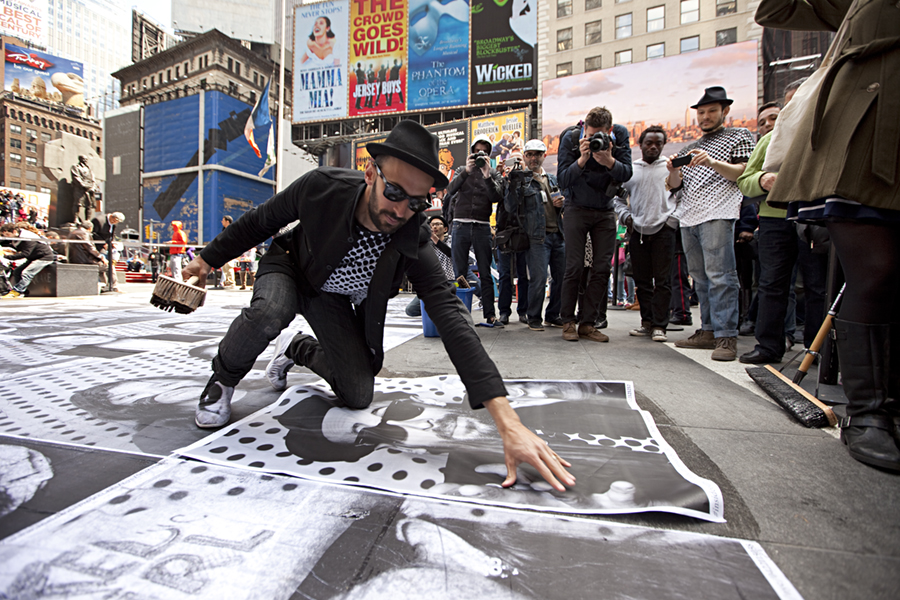 JR pasting in Times Square INSIDE OUT PROJECT photo by Ka-Man Tse